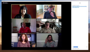 Virtual meeting with six deaf and hard of hearing participants; four women and two men. Two of the participants are signing, while the others are watching. A chat pane shows a web URL under discussion.