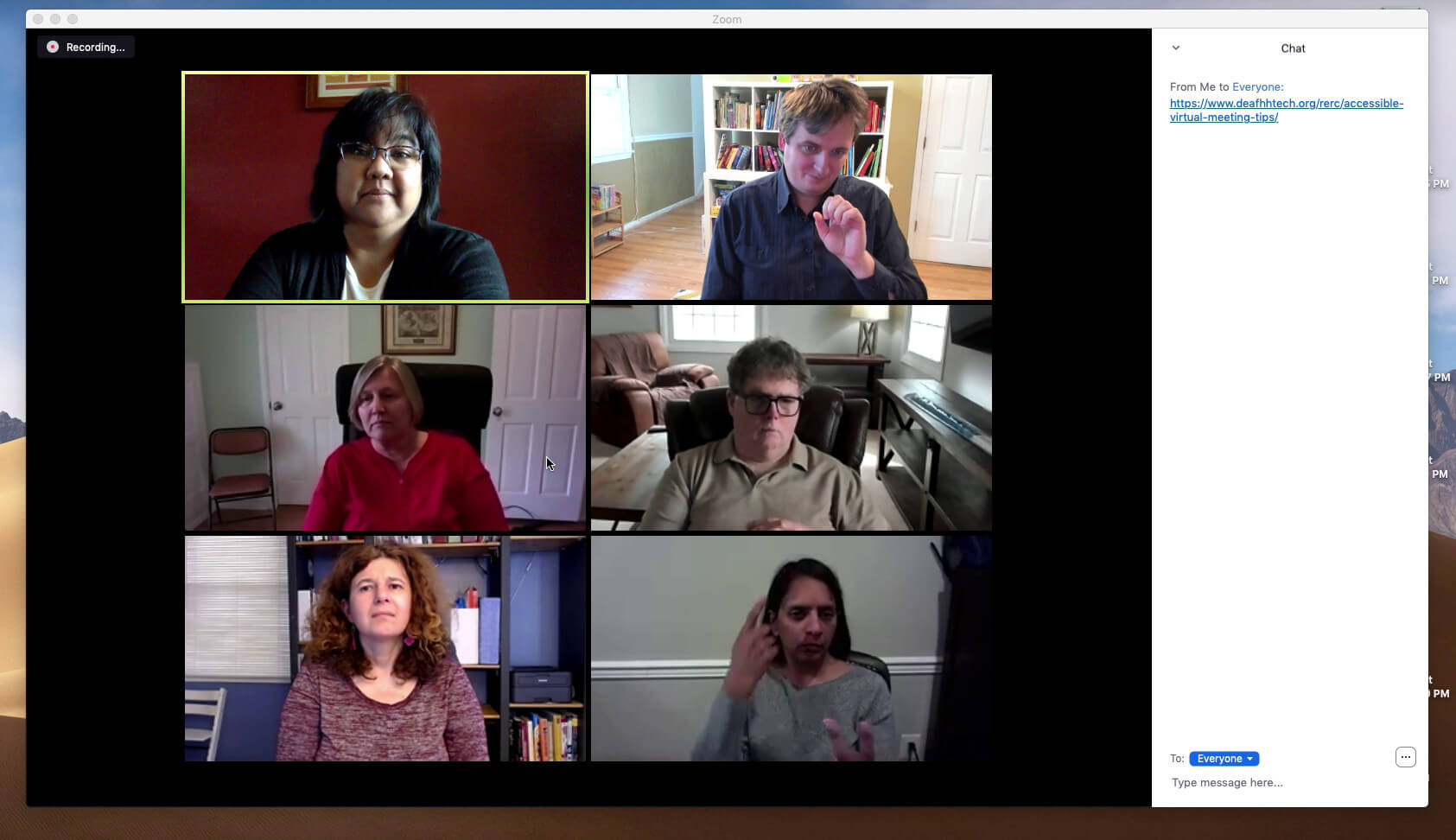 Video conference with six participants; four women and two men. Two of the participants are signing, while the others are watching. A chat pane shows a web URL under discussion.