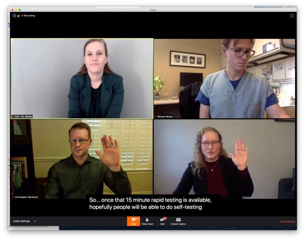 Panelist raising hand, with CDI mirroring. Four videos are visible, two of which show the signing panelists, and two of which show the CDIs shadowing the respective panelists. The videos are shown in a 2x2 grid. The bottom row shows the presenter and the CDI both raising their hands.